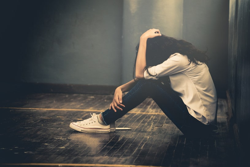 Addicted woman feels depressed and lonely.