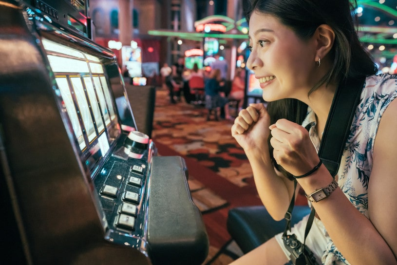Asian woman gambling in casino.