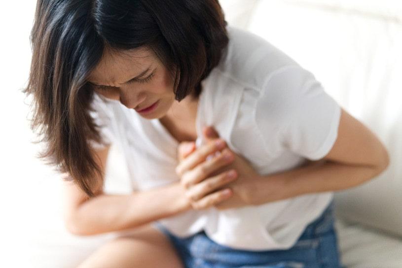 Asian woman having heart attack.