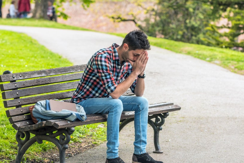 Asian male suffers from everyday stress.