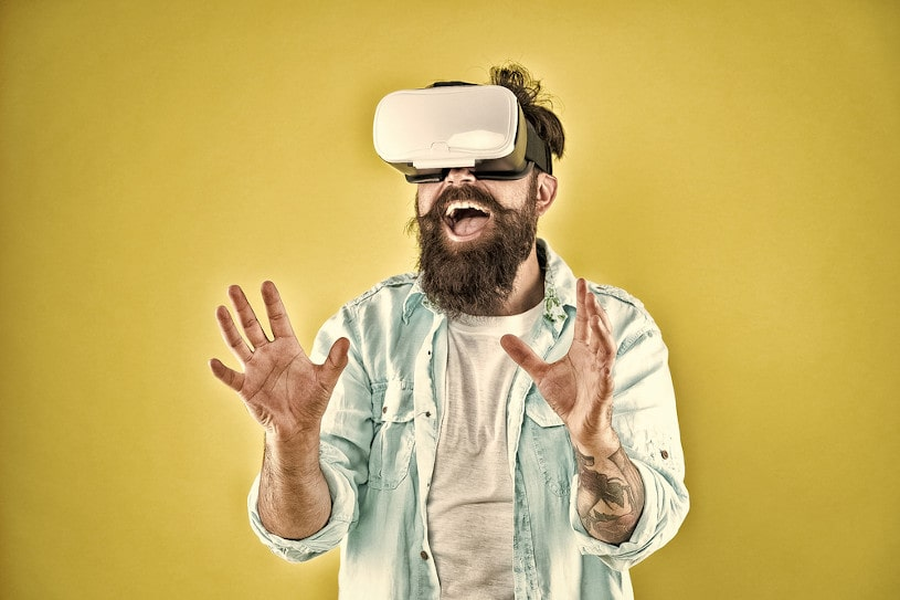 Hipster man play game in vr glasses.