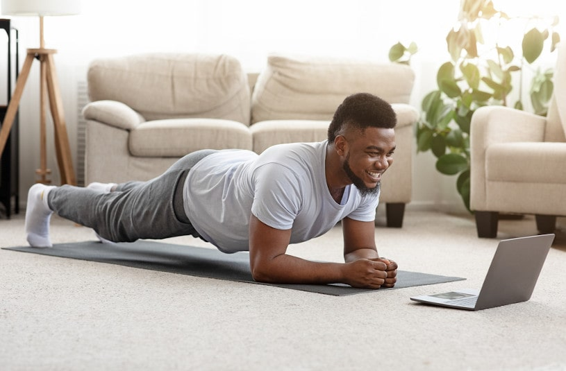 Sporty man doing yoga plank.