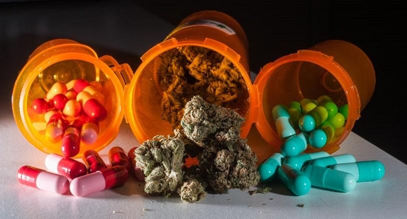 Cannabis and Xanax pills in bottles.