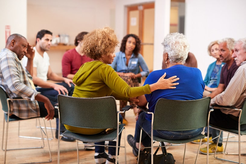 People Attending Self Help Therapy Group Meeting.
