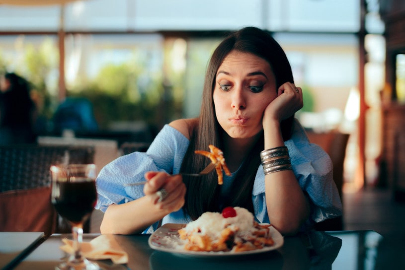 Woman Feeling Sick While Eating Huge Meal.