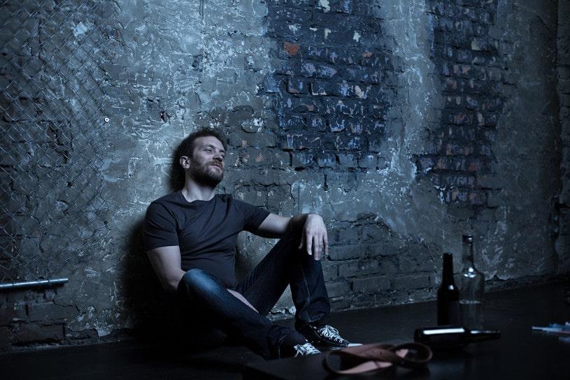 addicted man sitting in despair.
