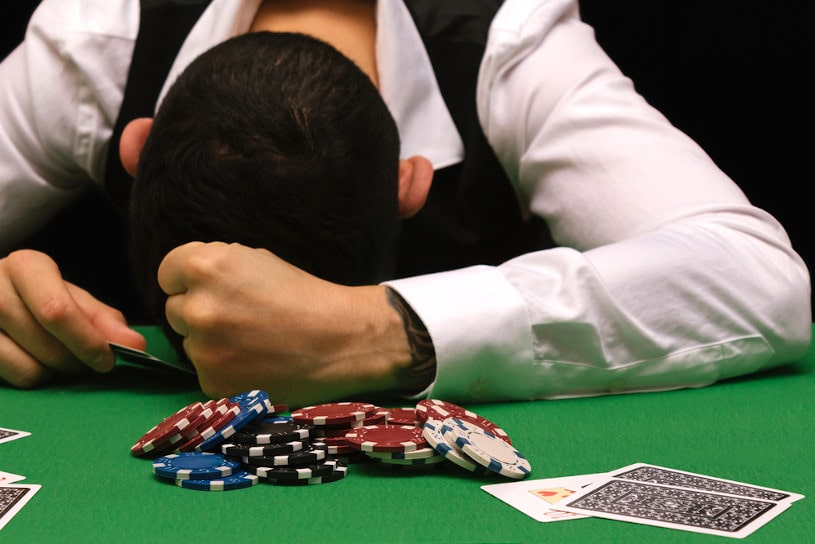 gambler man losing a lot of money.