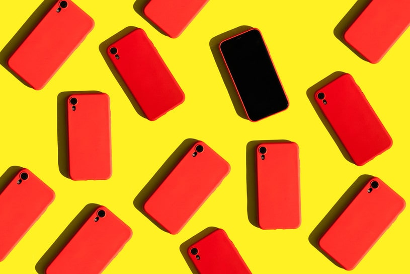 many red cell phones on yellow background.