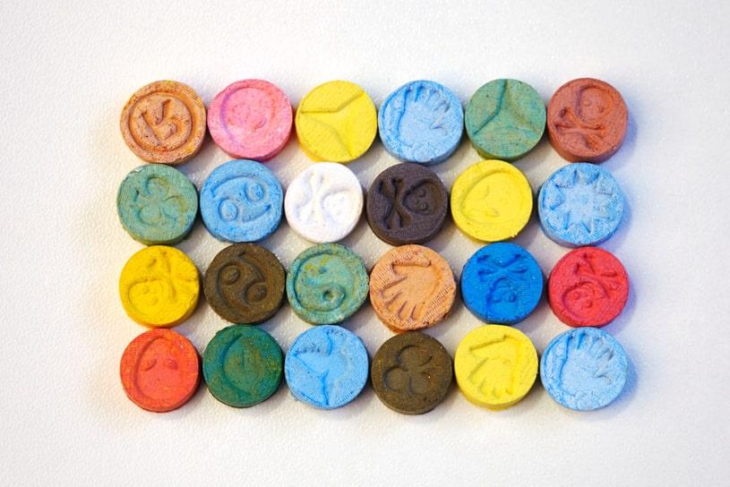 Multi-colored MDMA pills.