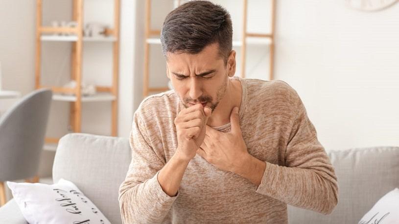 Coughing man.
