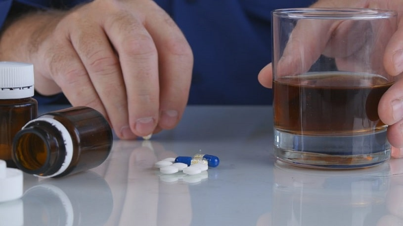 Man taking hydrocodone with alcohol.
