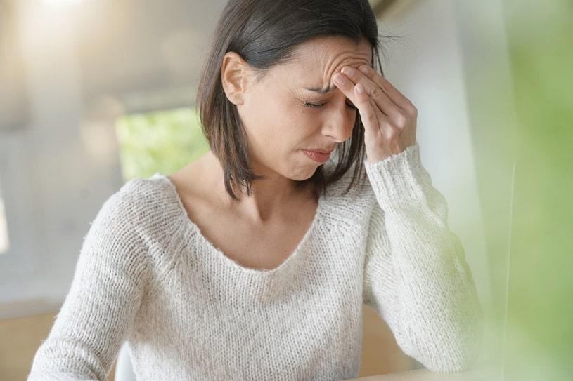 Woman suffering from hydrocodone side effects.