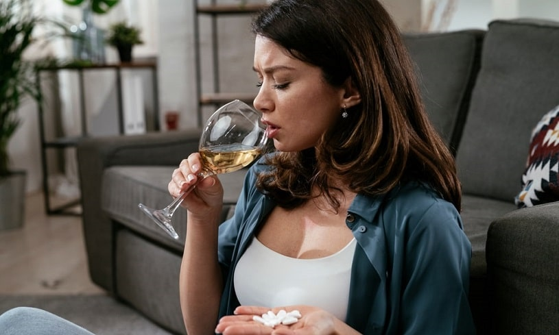 Young women drinking Morphine and wine.
