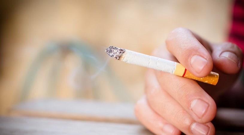 Cigarette in a hand.