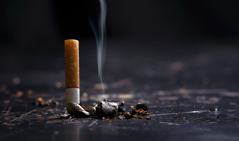 Cigarette but on the floor.