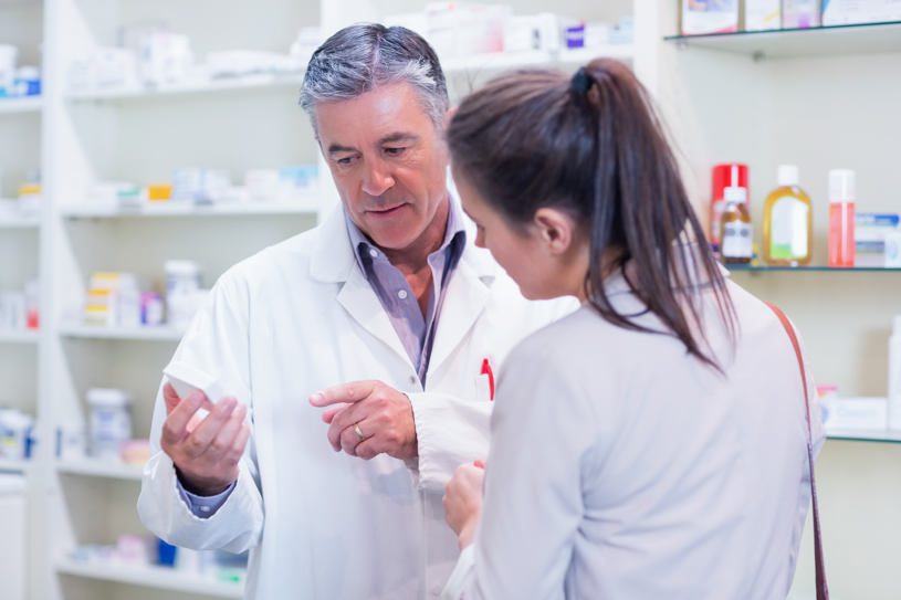 A man is showing different drugs in a drug store