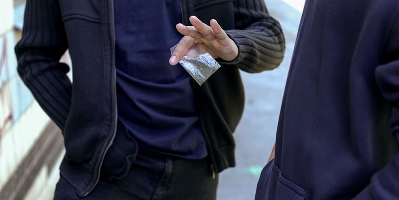 Dealer selling marijuana in the street.