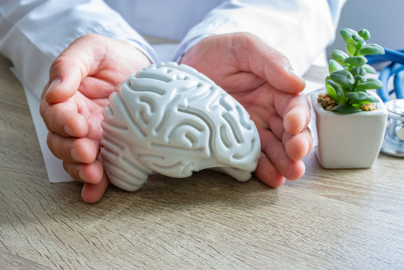 Doctor surrounded figure of human brain.