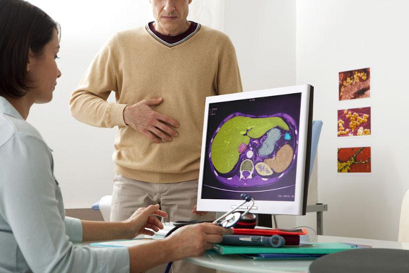 Doctor examine patient's liver.