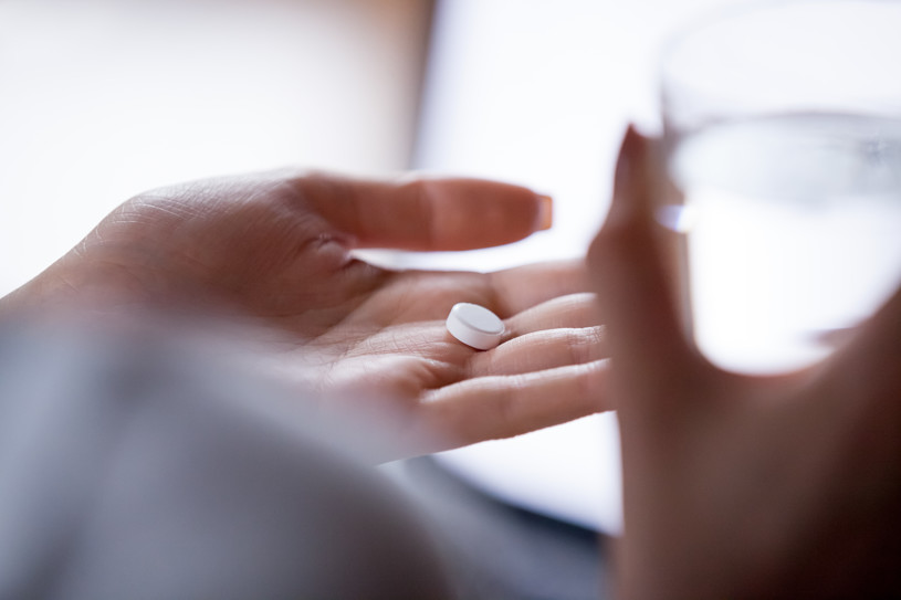 Flexeril pill in a hand.