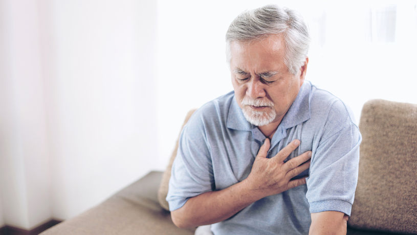 Senior male Asian suffering from heart attack.