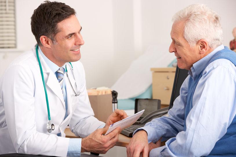 Doctor talking to the senior man.