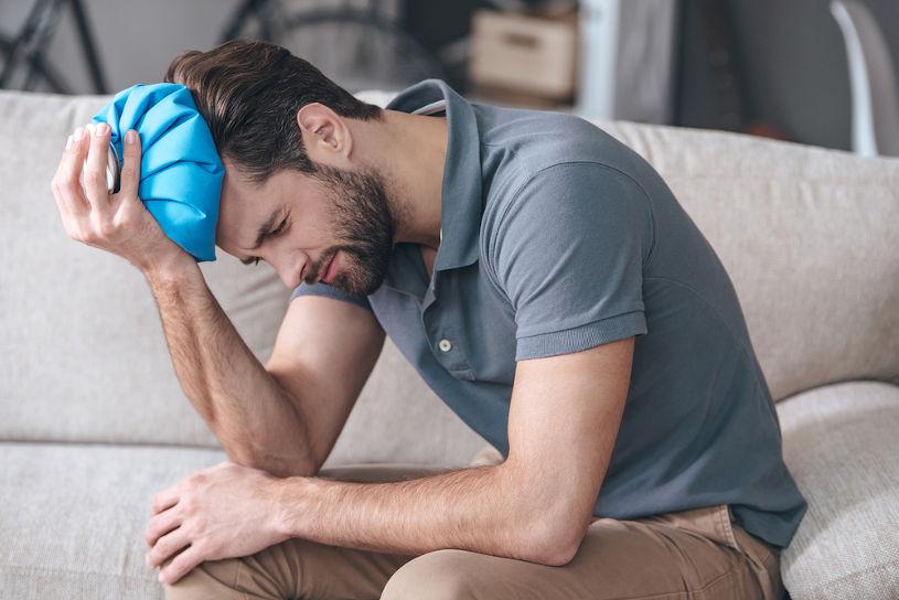 Man feeling terrible hangover headache.