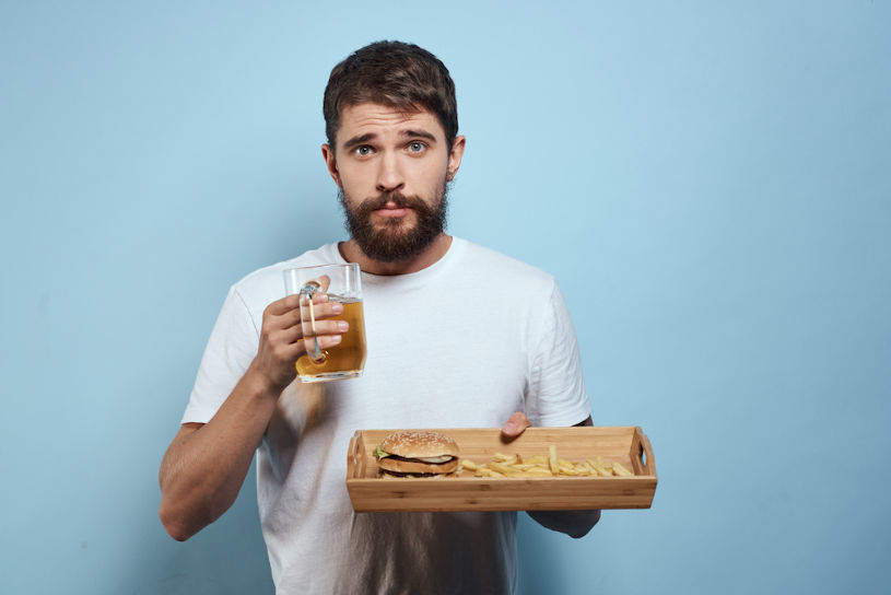 Man with beer and fast food.
