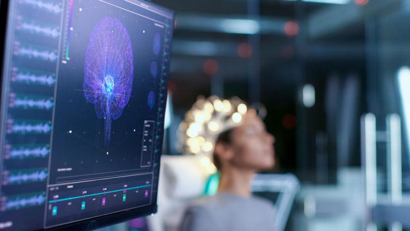 Woman wearing brainwave scanning headset.