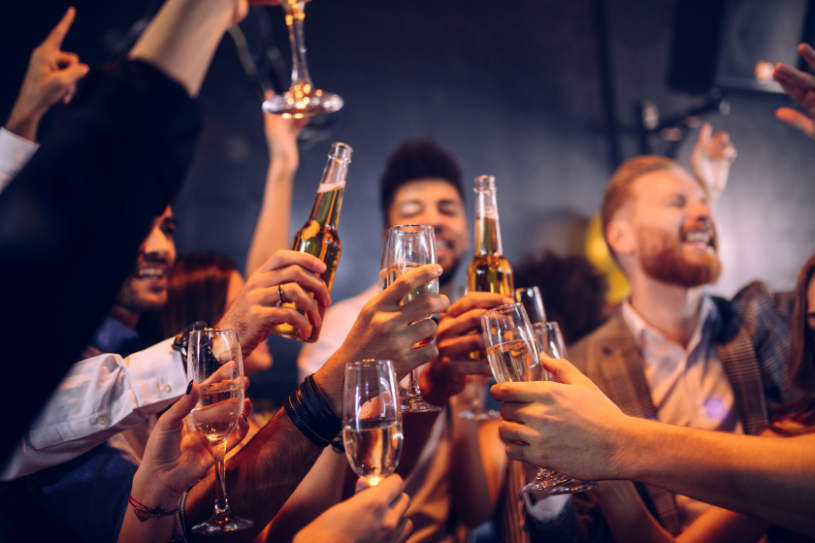 A group of people drinking alcohol.