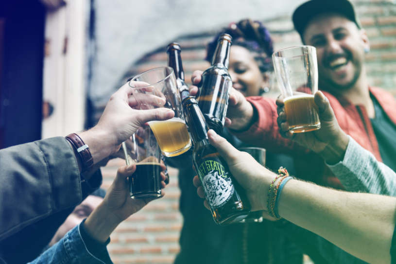 A group of young people drinking alcohol.
