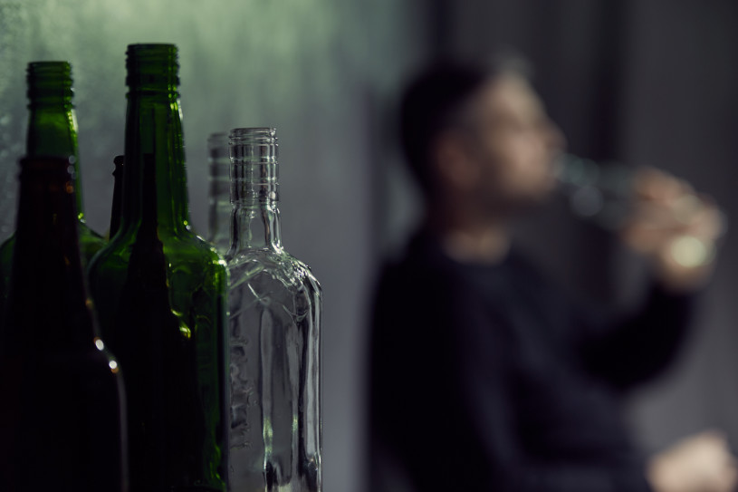 A man drinking alcohol.