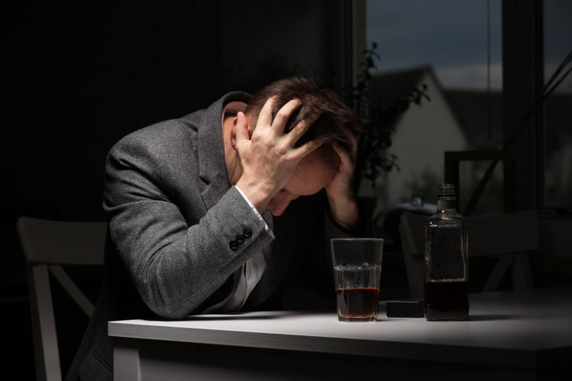 A man is experiencing side effects of alcohol withdrawal.