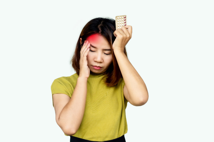 A woman experiences with a severe headache suffers from Lexapro side effects.