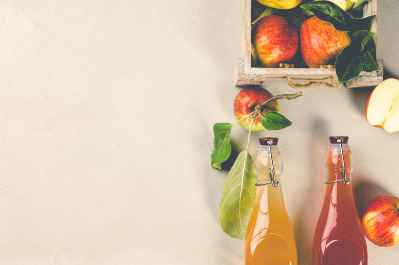Apples and bottles of fresh juice, how to detox from alcohol at home.