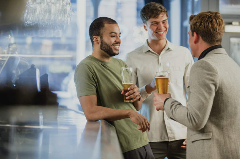 Danger of social drinking, male friends drink alcohol.