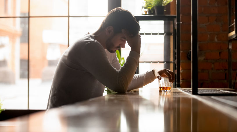Depressed man is trying to quit drinking alcohol.