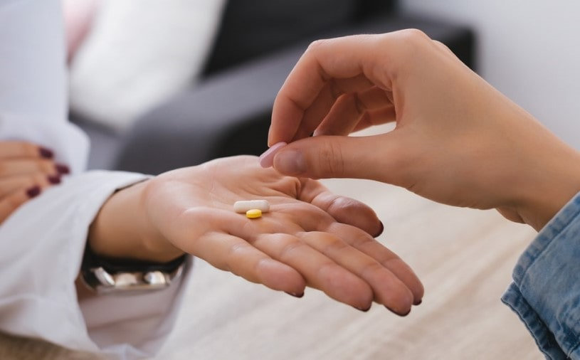 Doctor giving Klonopin pills to a patient.