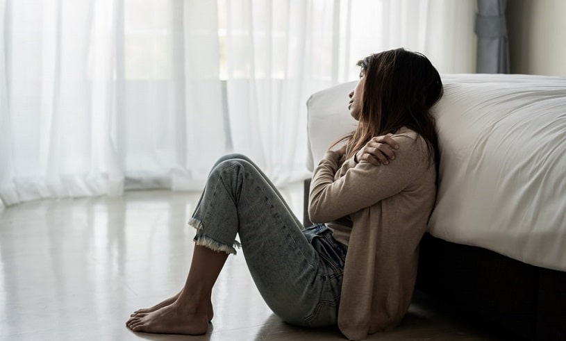 Depressed woman suffering from Seroquel withdrawal.