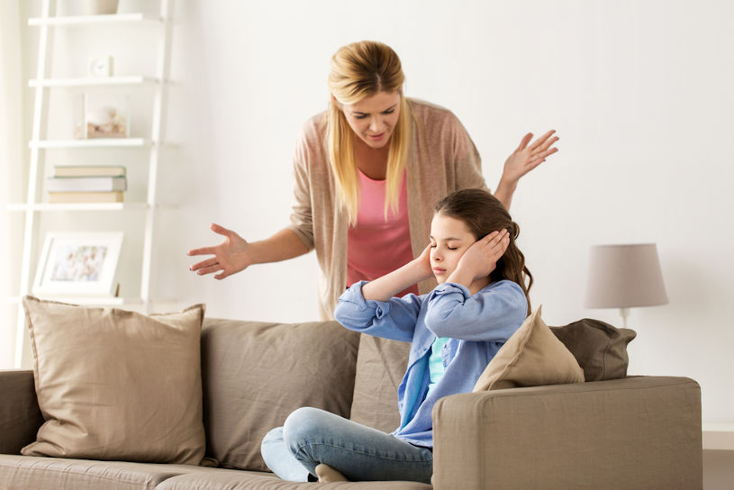 Woman crying at her daughter.