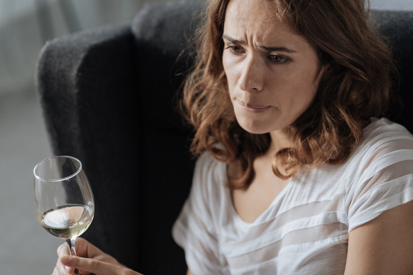 Woman with a glass of wine in her hand.