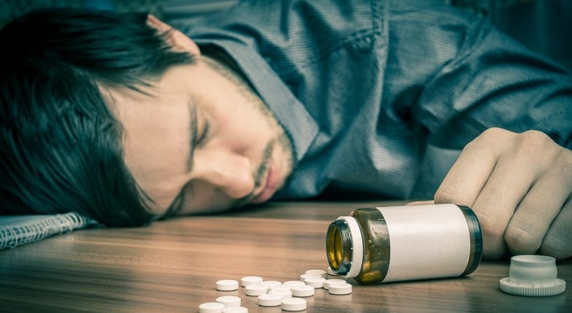 Man lying on the floor after Valium overdose.