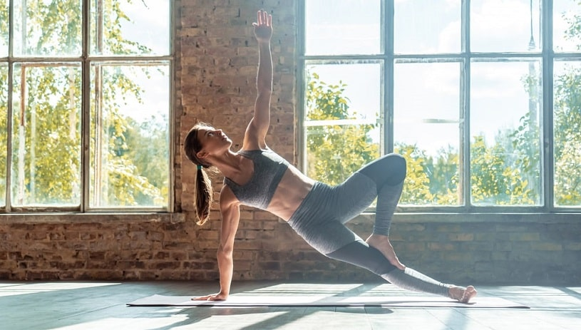 Woman practicing yoga to return weight after effexor weight gain.