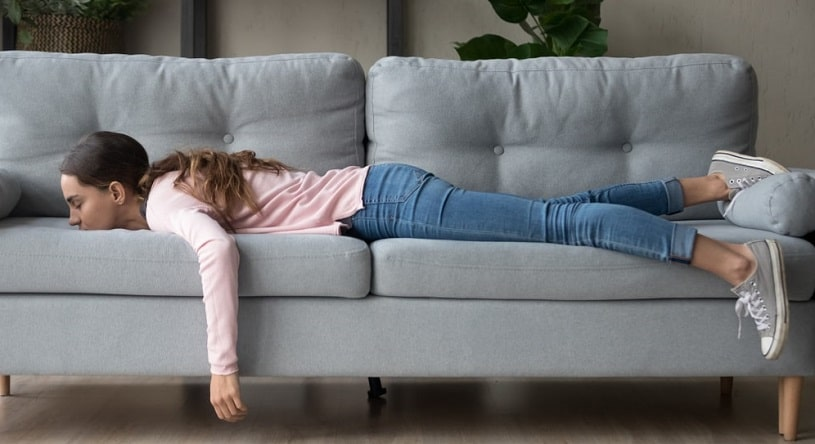 Girl lying on the couch after taking Klonopin.