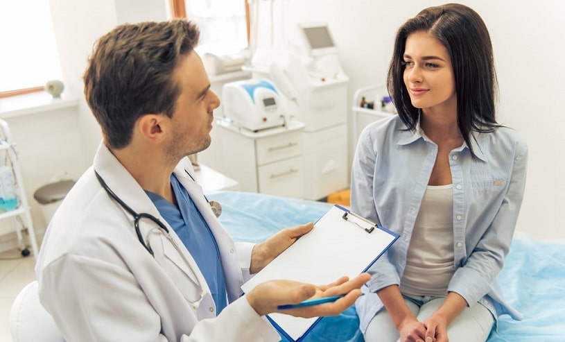 Doctor telling a patient about norco drug interactions in the hospital.