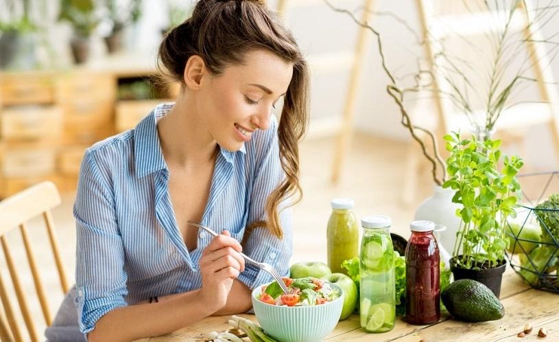 Woman eating healthy food, salad.