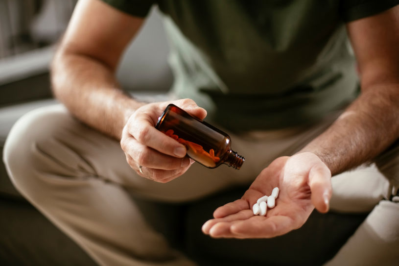 A man holds Phenazepam pills in his hand.