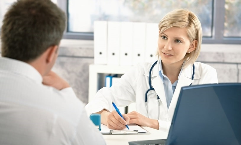 Doctor prescribing Probuphine implant to a patient, writing something.