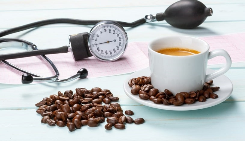 Coffee cup and beans next to the tonometer.