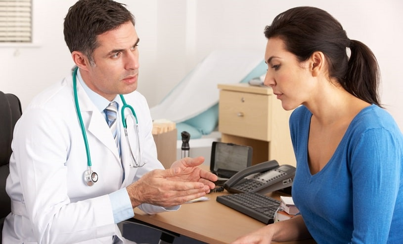 Doctor talking to his patient explaining something.